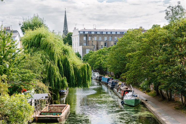 Canal with boats and residential buildings in Camden Town, London, UK