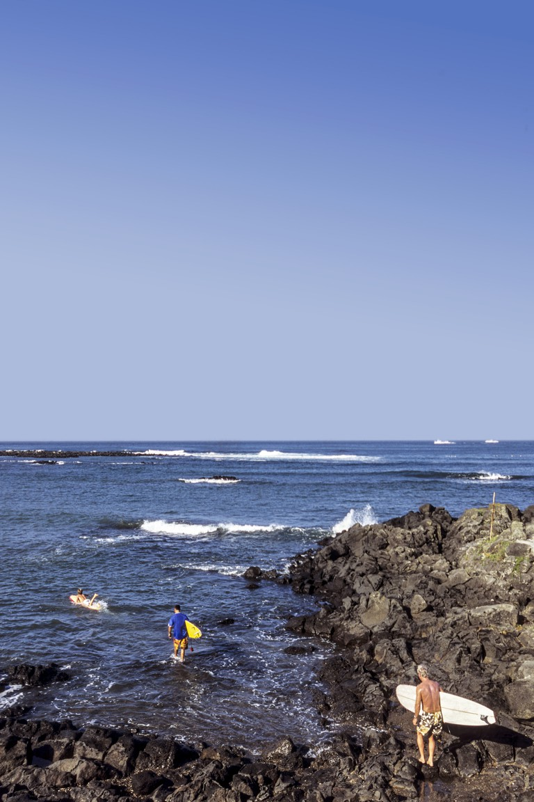 Three surfers on Jeju Island