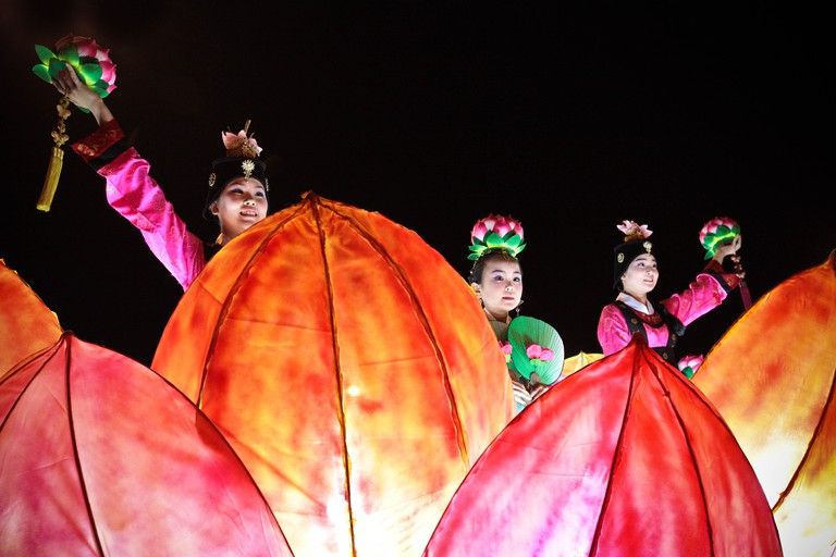 Women perform a dance on a parade float at a festival celebrating Buddha's birthday in Jeju City, South Korea.
