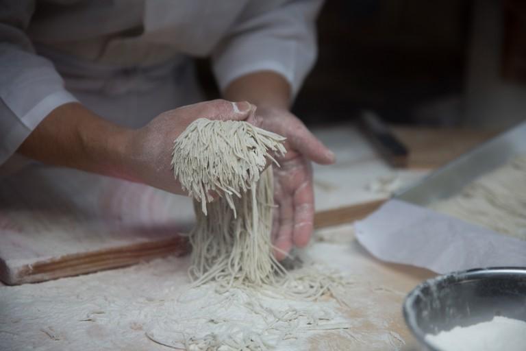 Soba making at a restaurant in Japan.