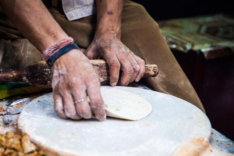 A man making parathas in Old Delhi