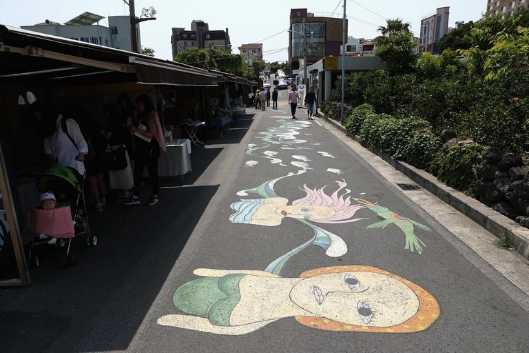 Artwork is seen on the path in Lee Jung Seop Street in Seogwipo, South Korea.