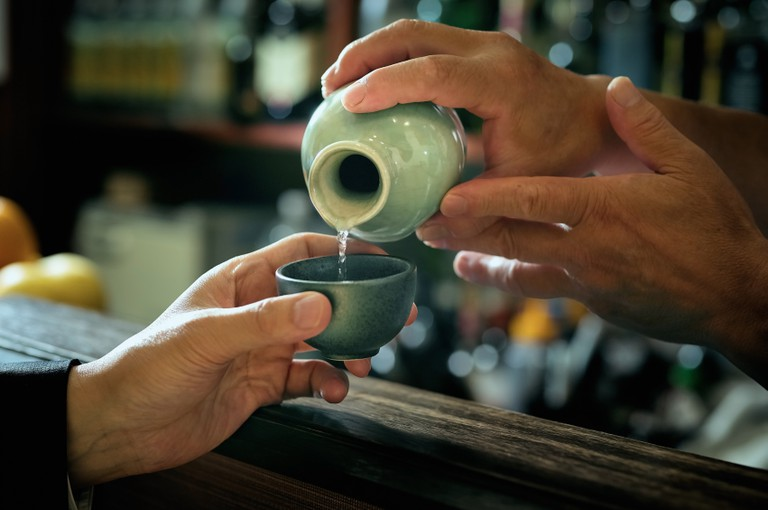 Bartender pouring Sake in Japan