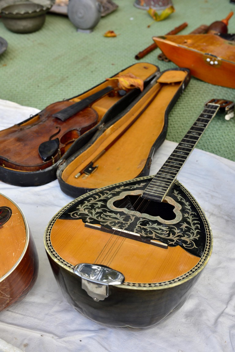 Stringed musical instruments, bouzouki, violin on sale in street flea market, Athens, Greece