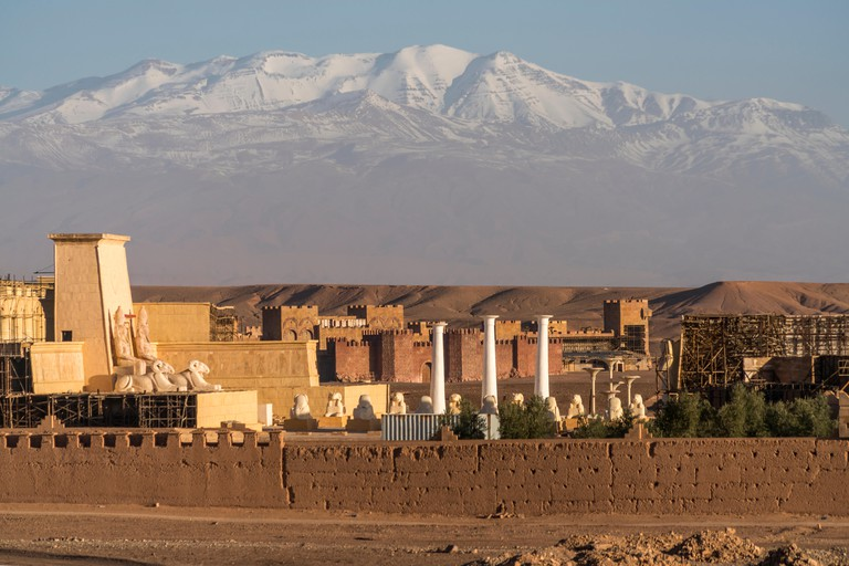 Sets are seen at Atlas Corporation Studios with the snow-covered Atlas mountains in the background