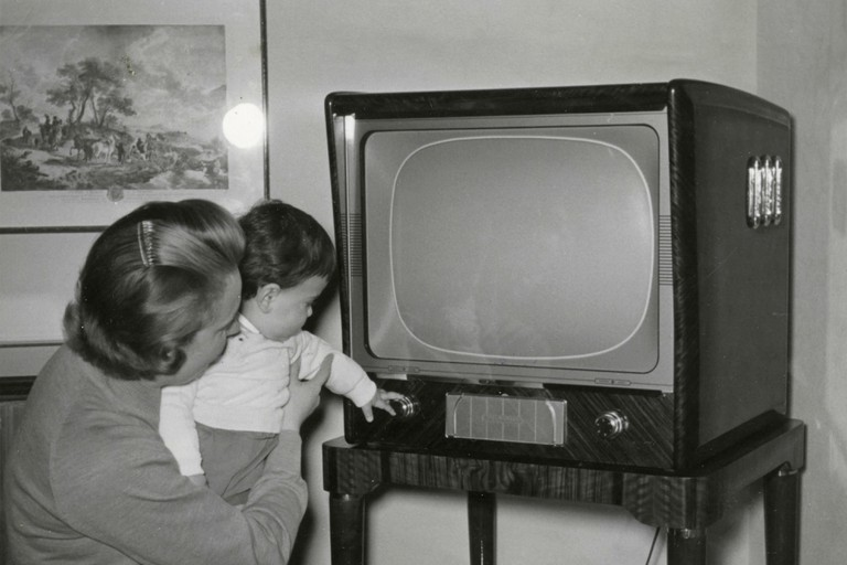 Old TV set at home, Italy 1960s