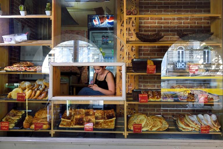 Georgia, Tbilisi, Merab Kostava street, khachapuri saleswoman