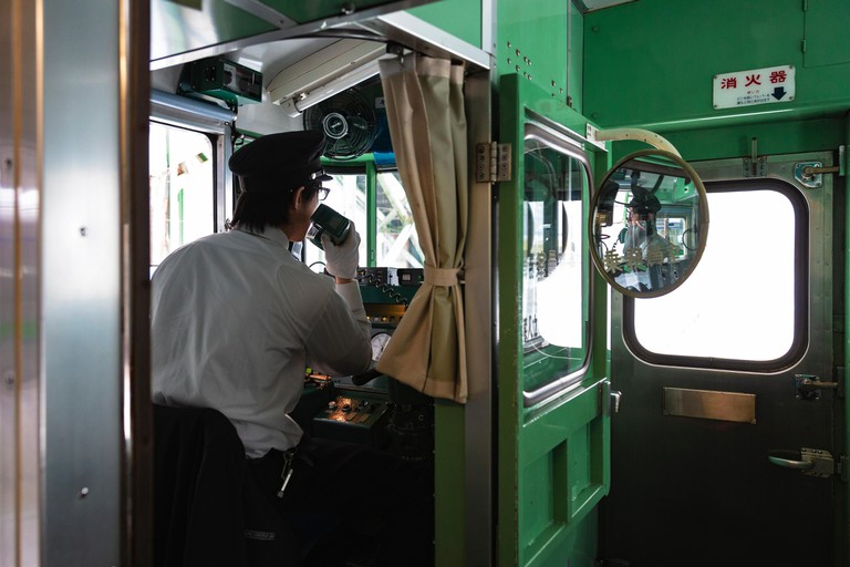 A train driver at Kutchan Station on the Japan Rail (JR) Hakodate serving surrounding Niseko region