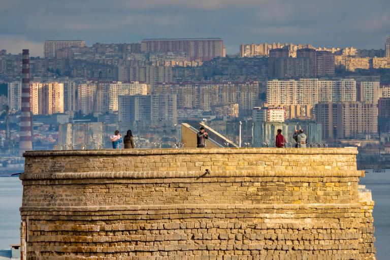 Tourists on top of Maiden Tower, Baku, Azerbaijan