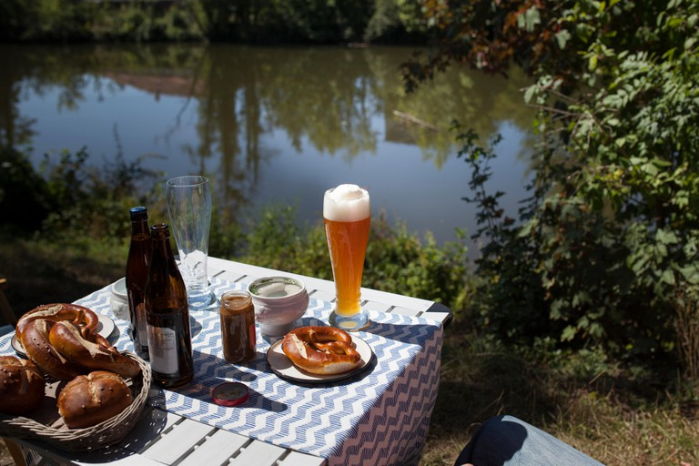 Breakfast with Bavarian veal sausage, wheat beer and pretzls