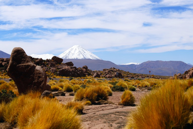View of Licancabur volcano along the road to the El Tatio geysers near the Termas de Puritama, Atacama Desert, Chile