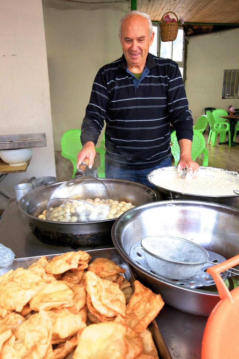 Man Making Loukoumades A Cypriot Dessert, Pafos, Cyprus, Eastern Mediterranean Sea