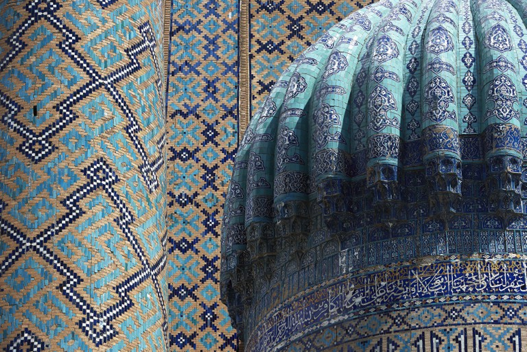 Mosaics surround the dome of the Sher-Dor Madrassah, 17th century, Registan square, Samarkand