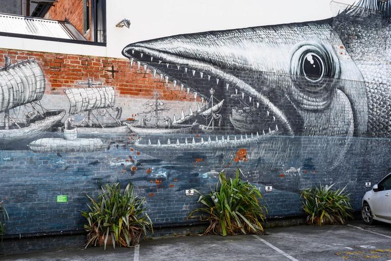 A street art mural by British artist Phlegm in Dunedin