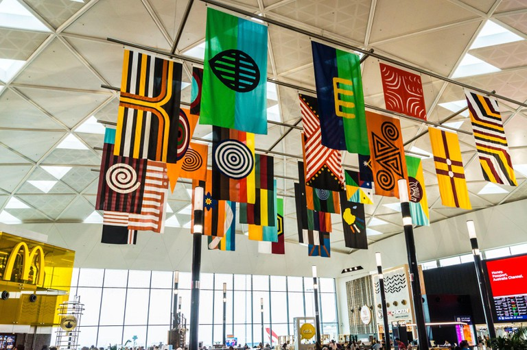First Nation Flags installation by Archie Moore, 2018, Sydney airport international departures terminal 1