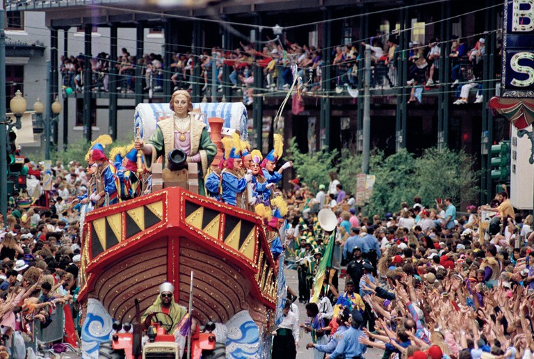 The King of carnival float makes its way down St. Charles Avenue in New Orleans on Mardi Gras Day