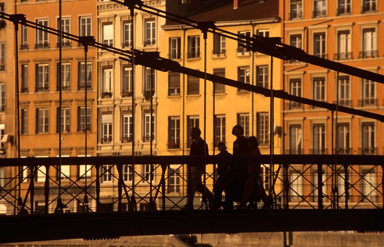Footbridge over the river saone in the evening sunlight Lyon France Europe