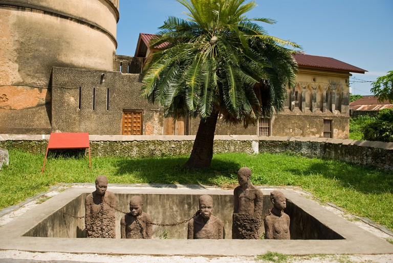 The 'Memory for the Slaves' monument in front of the Anglican Christ Church Cathedral's garden in Stone Town