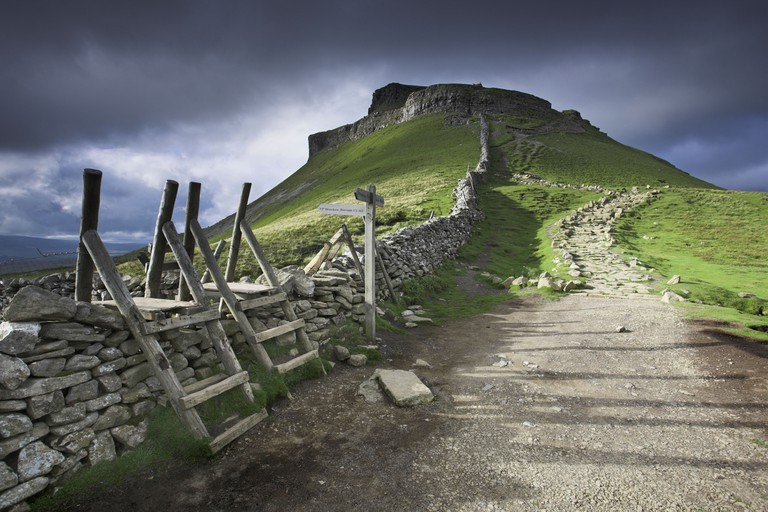 The Pennine Way footpath and distinctive peak of Pen-Y-Ghent, Ribblesdale, Yorkshire Dales