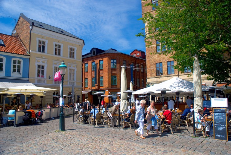 Lilla Torg square in Malmo, Sweden, is a popular spot for outdoor dining with its nice restaurants and relaxed atmosphere.