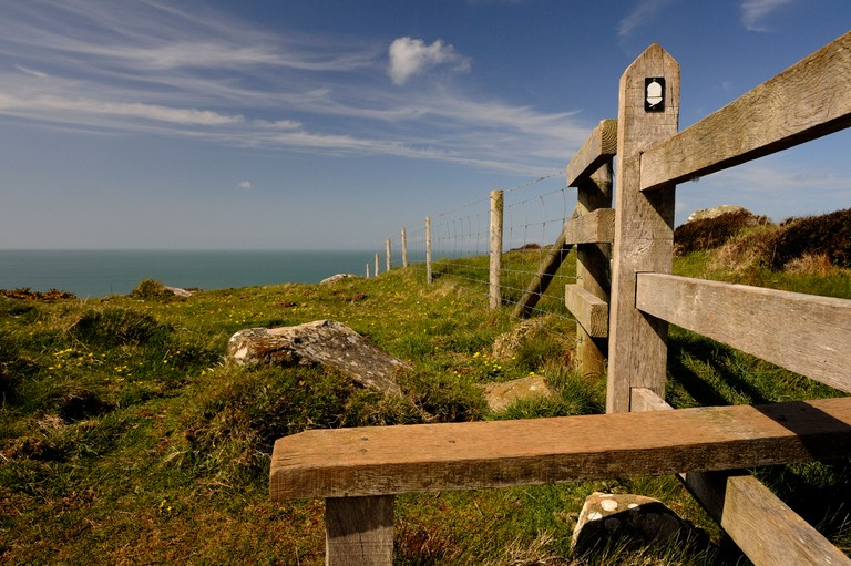 Stile and signpost between Abereiddy and Whitesands Bay on the Pembrokeshire coast path