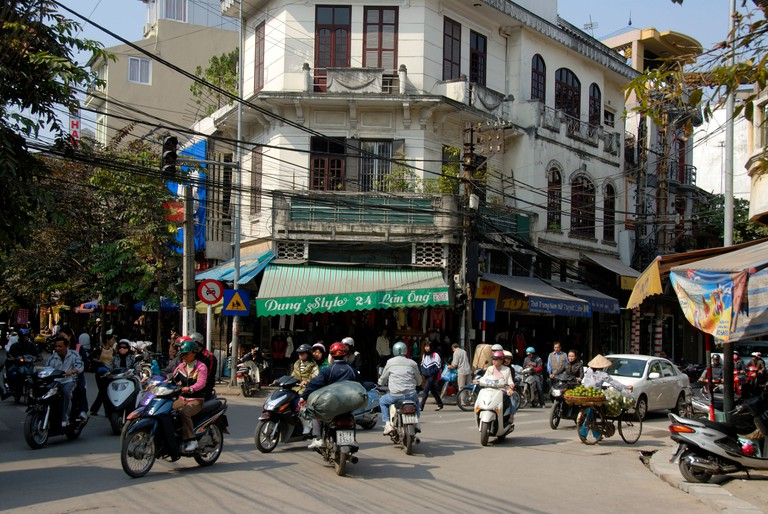 Moped drivers on the Lan Ong intersection, Hanoi