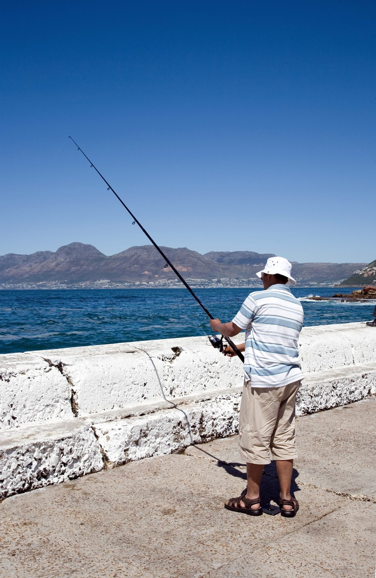 Fishing off the pier in Cape Town