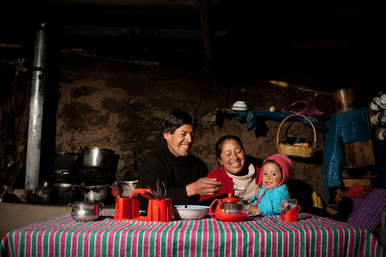 A happy peruvian family eating their dinner