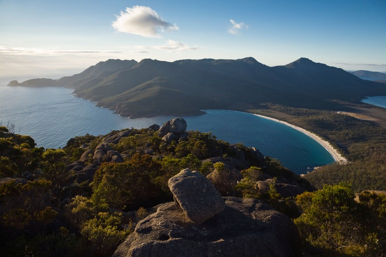 Sunrise view of Wineglass Bay from Mt Amos. Freycinet National Park, Tasmania.