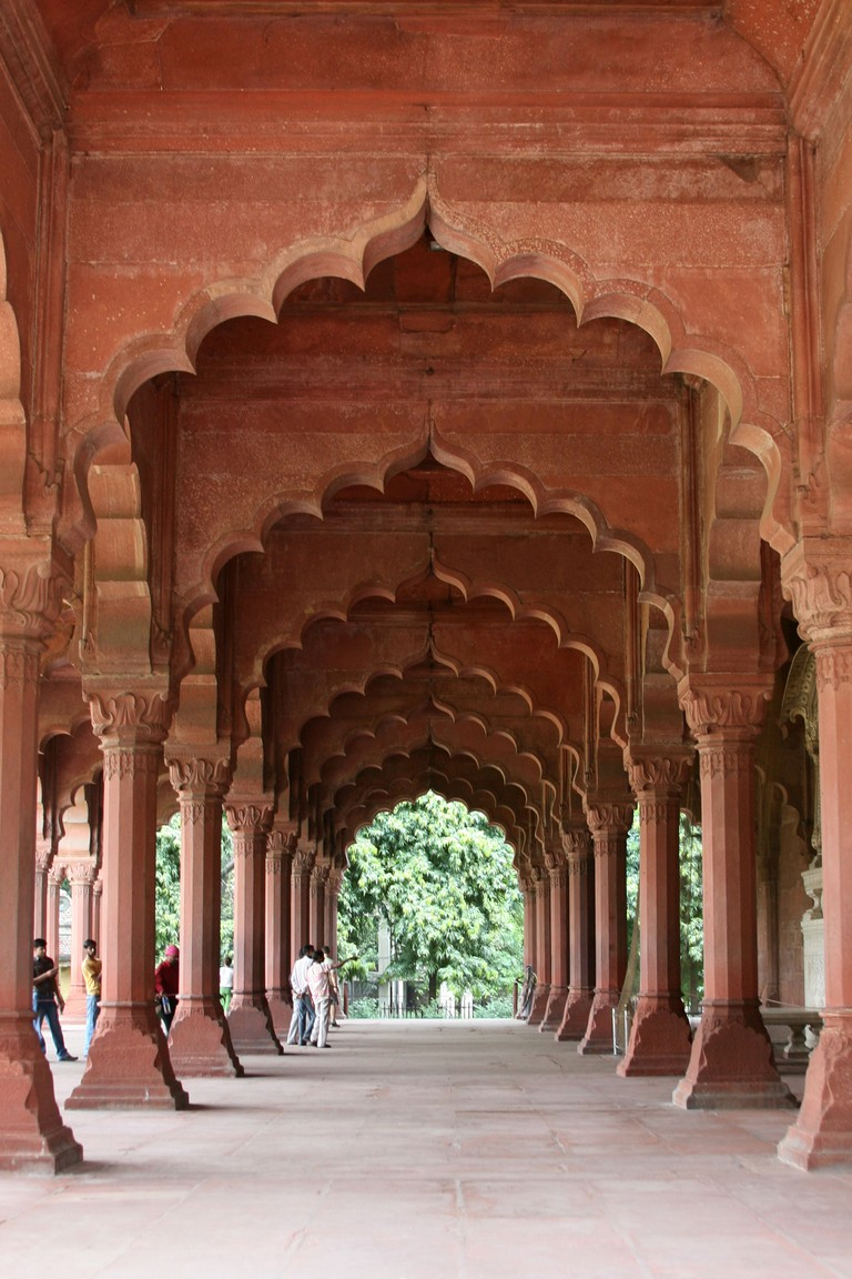 View through red sandstone archways in the Diwn-i-Am Hall of Public Audience at the Red Fort, Delhi.
