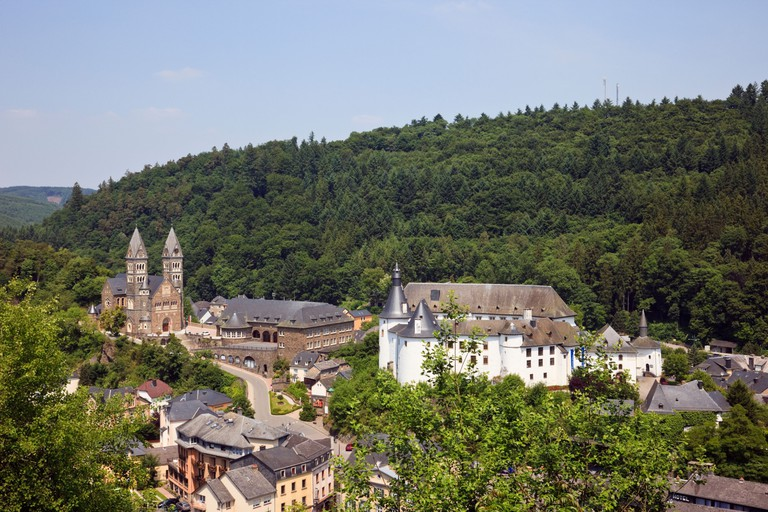 Clervaux, Luxembourg. Castle and Benedictine Abbey in medieval town in Clerve valley in wooded hills and valleys of the Ardennes