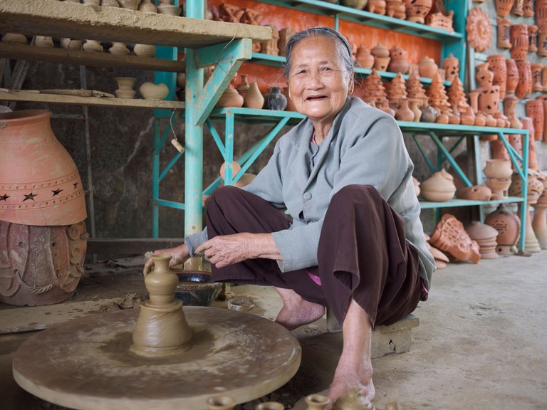 Woman making pottery in village of Thanh Ha