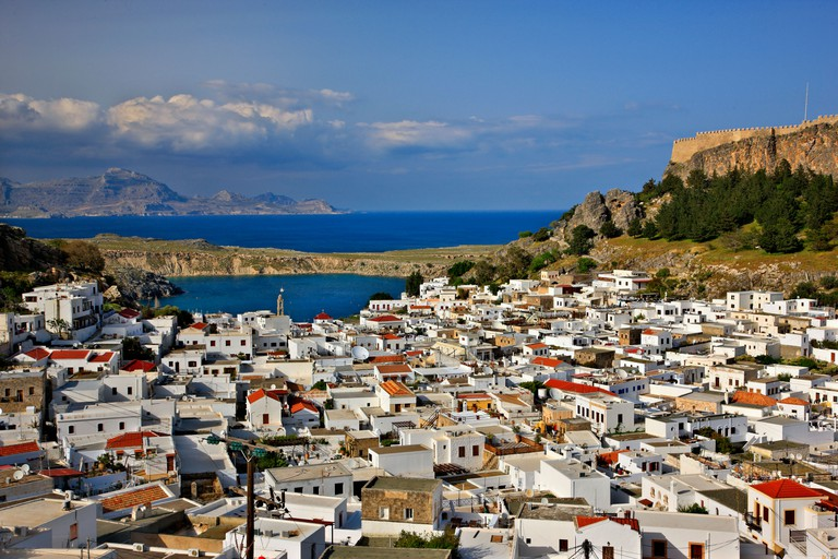 Panoramic view of beautiful Lindos village with its castle (Acropolis) . Rhodes island, Dodecanese, Greece