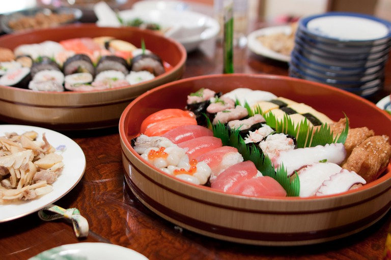 A traditional Japanaese dinner of sushi and sashimi