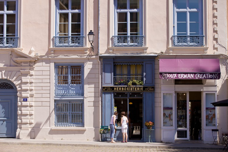 France, Rhone, Lyon, historical site listed as World Heritage by UNESCO, Vieux Lyon (Old Town), Place Saint Jean and shops