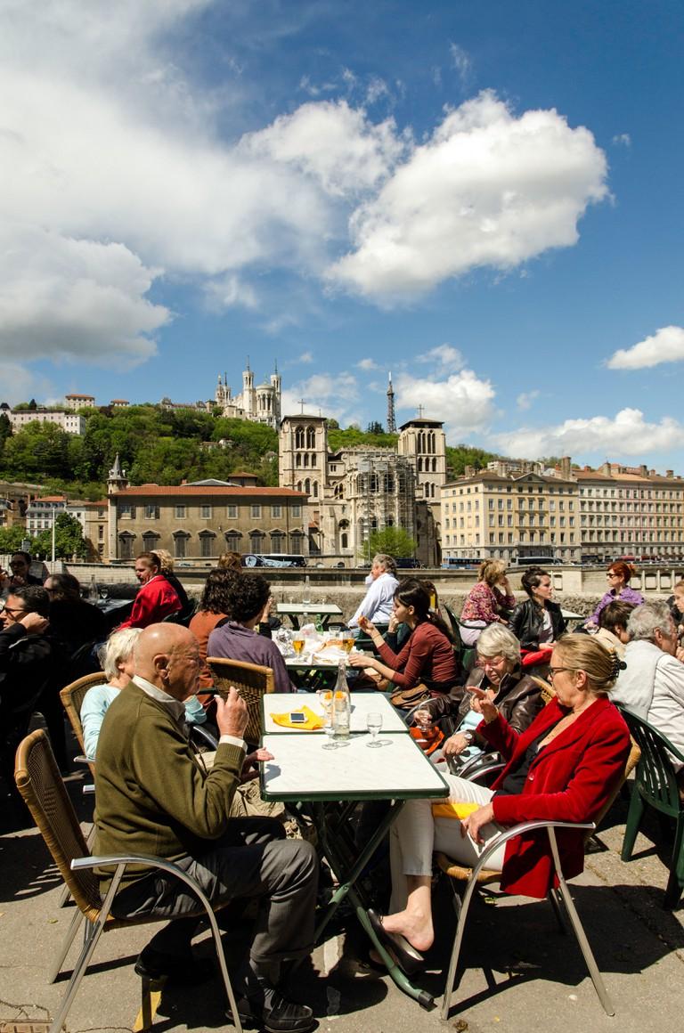 People enjoying the sun in an outdoor bar Lyon France Europe