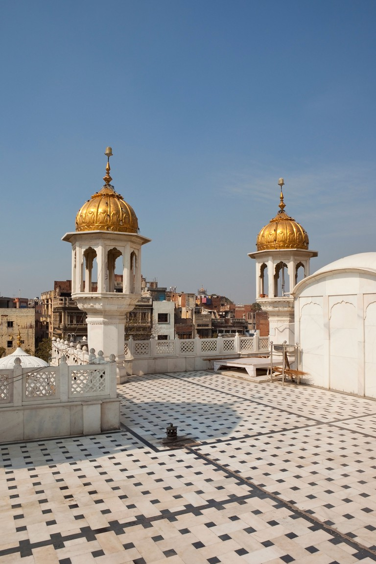 Decorative architecture with ornamental minarets and marble flooring at the Golden Temple, Amritsar Punjab, India.