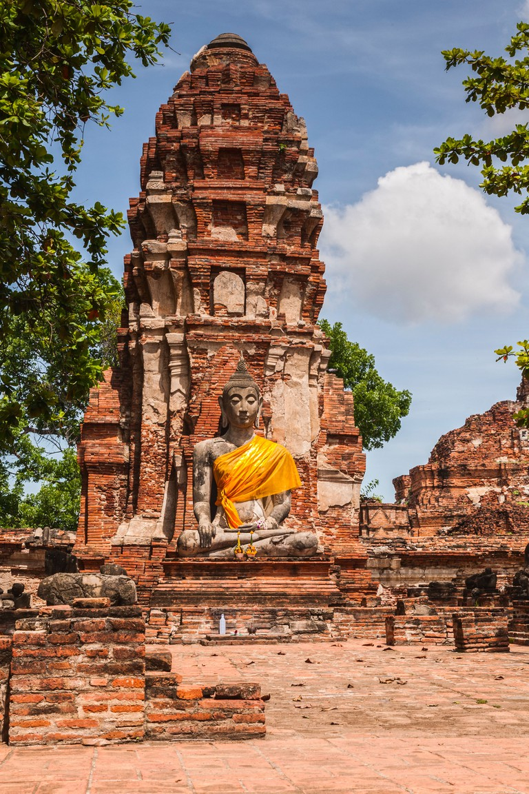 Stone Buddha figure in a ruined temple in Ayutthaya Historical Park...