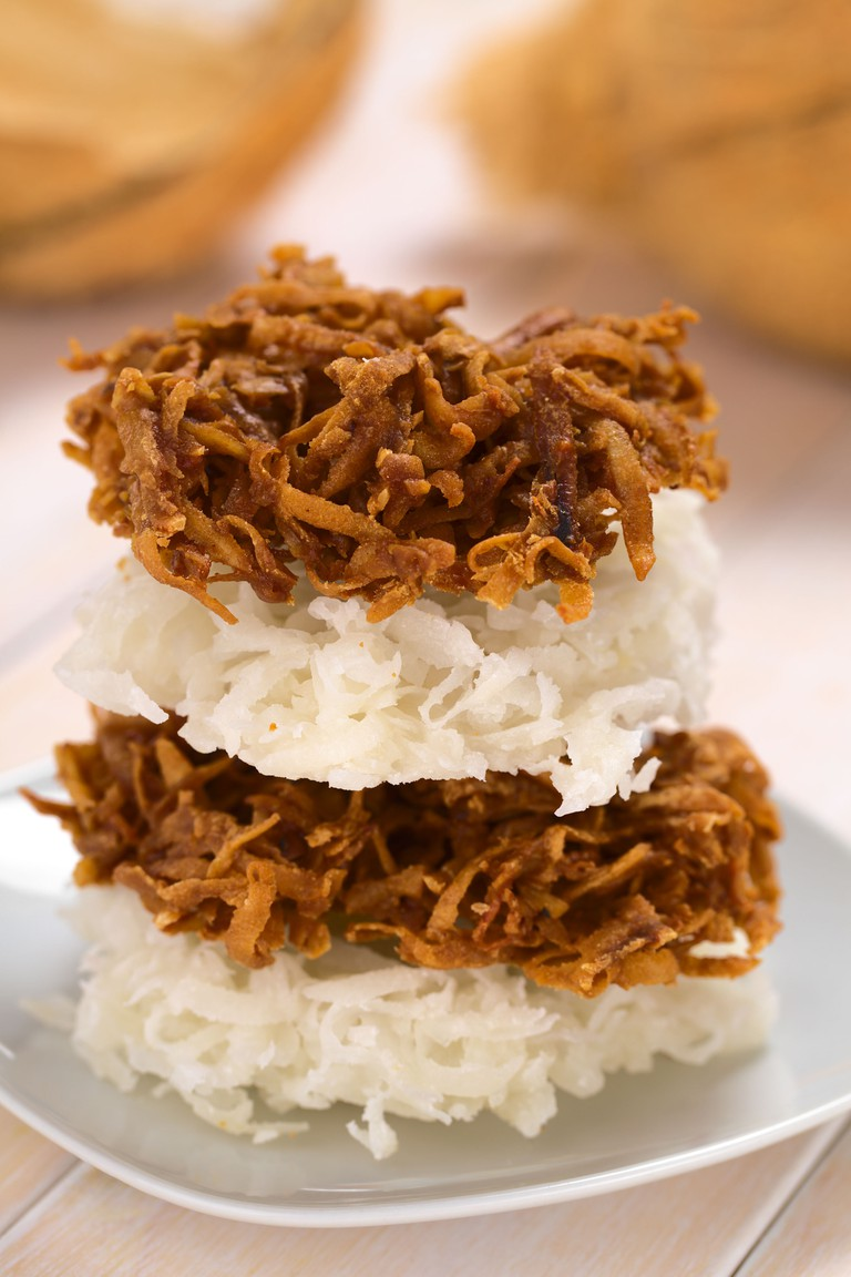 Peruvian cocadas, a traditional coconut dessert sold usually on the streets, made of grated coconut and white or brown sugar. Image shot 2013. Exact date unknown.