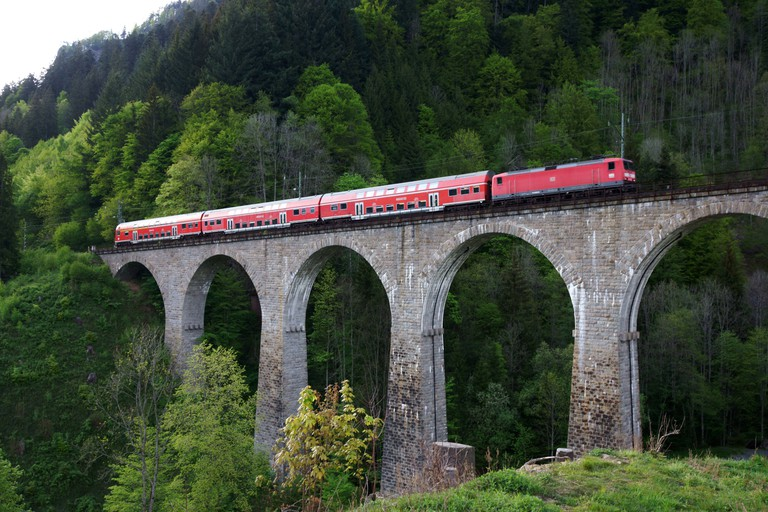 Train passing over historic Hoellental railroad viaduct ,Black Forest, Wurttemberg, Germany