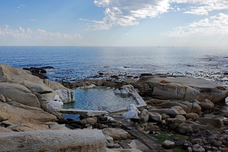 Tidal pool at Saunders Rocks beach , Sea Point, Cape Town.