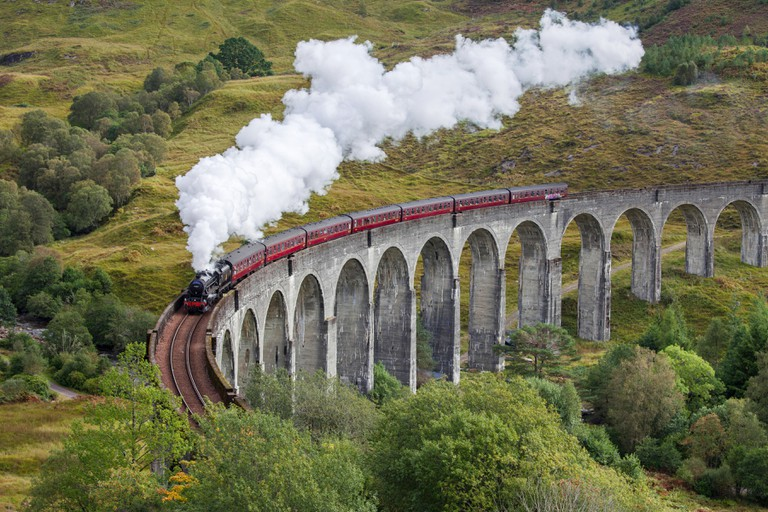 The Jacobite steam train on the Glenfinnan Viaduct, West Highland Line in Scotland.