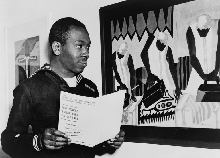 Coast Guardsman Jacob Lawrence, with his paintings at the Institute of Modern Art in Boston in 1945. During World War 2,
