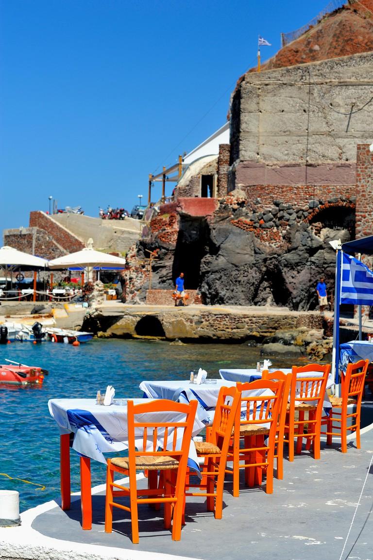 Fish Restaurant table and chairs in Amoudi bay Santorini Greece