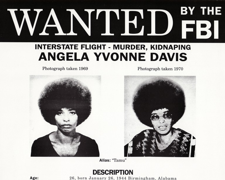FBI Wanted poster for Angela Davis. Angela Yvonne Davis (born January 26, 1944) is an American political activist, scholar, and author. She emerged as a prominent counterculture activist and radical in the 1960s as a leader of the Communist Party USA, and