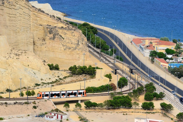 high-speed train traveling by train along the coast. Alicante, Spain