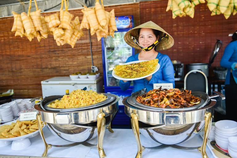 A woman shows dishes at Vietnam's Southern Food Festival in Ho Chi Minh City, Vietnam.