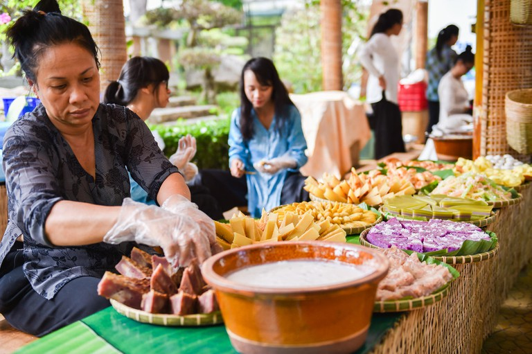 A woman makes food at a Vietnam Food Festival in Ho Chi Minh City, Vietnam.