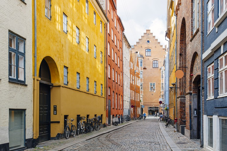 Colourful houses and cobblestone in Copenhagen, Denmark