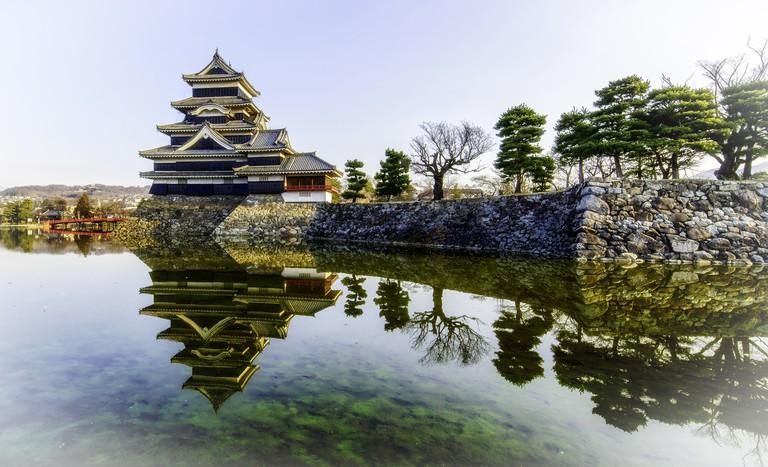 Matsumoto Castle reflecting in pond, Matsumoto, Japan